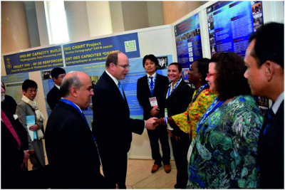HSH Prince Albert II of Monaco meeting some of the Nippon Foundation / GEBCO alumni in front of their poster display at the Capacity Building Poster Exhibition.